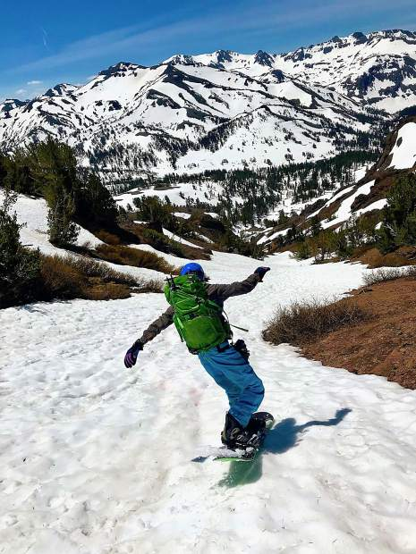 Snowboarding down a gully on Sonora Peak.