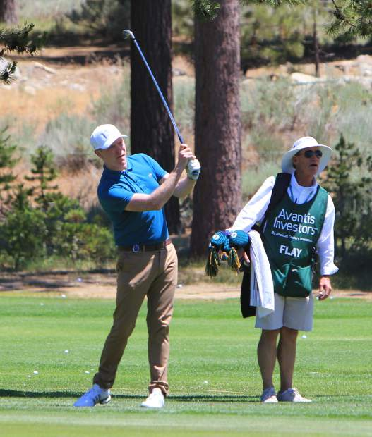 Bobby Flay hits an approach shot on the 18th hole.