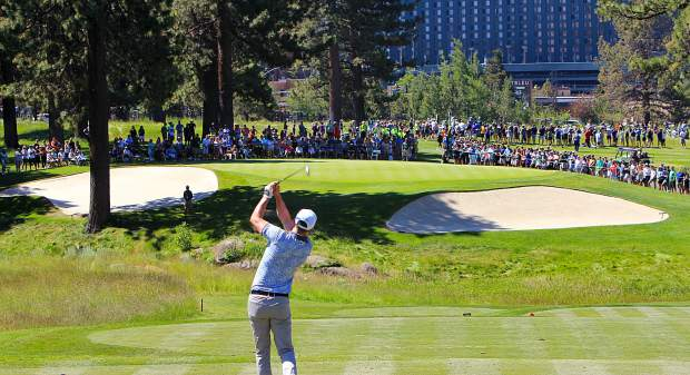 Justin Timberlake tees off on the 14th hole.