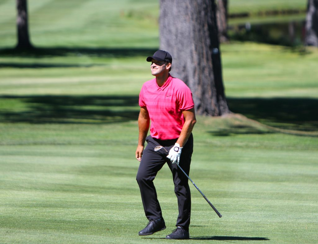 Tony Romo walks to the second green.