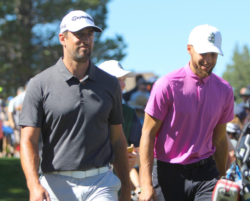 Aaron Rodgers and Stephen Curry share a laugh together.