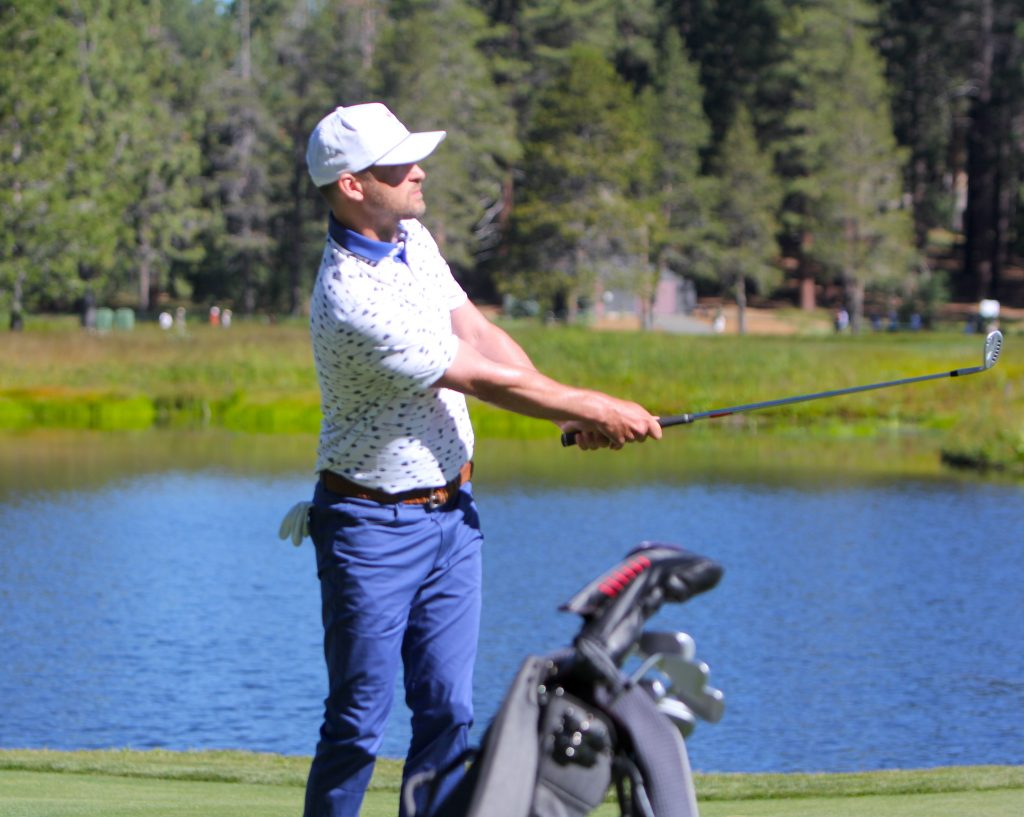 Justin Timberlake hits an approach on the first hole.