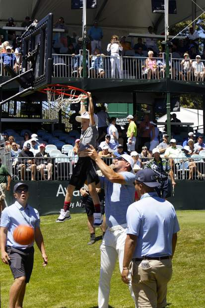 Mark Mulder lifts his son up for a dunk on hole 17.