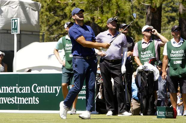 Two-time champion Tony Romo watches his shot from the 17th hole on Sunday, July 14.
