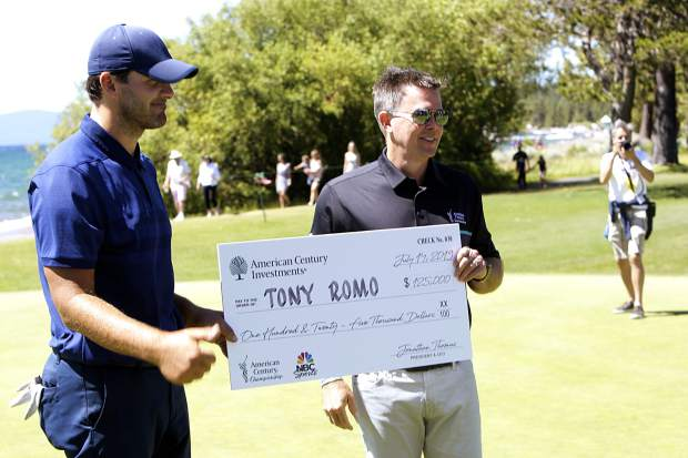 Tony Romo is awarded a check for $125,000 after winning the 2019 American Century Championship.