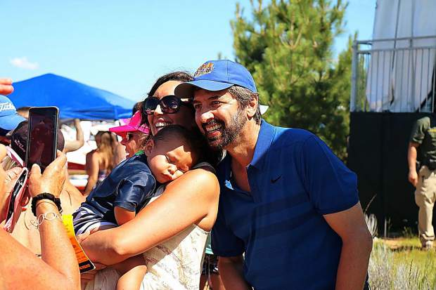 Everybody loves him: Comedian Ray Romano poses with a mother and her child on July 14, 2018, at Edgewood Golf Course.