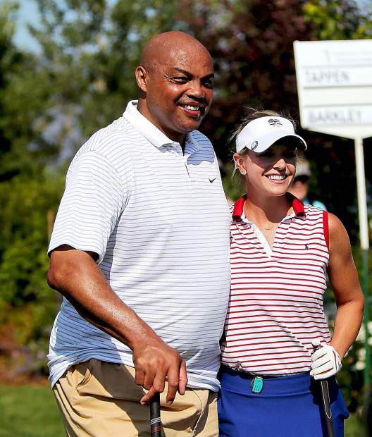 NBA Hall of Famer Charles Barkley and Kathryn Tappen smile before the final round of the 2018 American Century Championship.