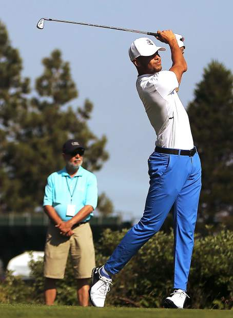Steph Curry of the Golden State Warriors watches his tee shot during the final round of the American Century Championship last year.