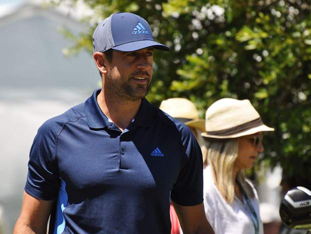NFL quarterback Aaron Rodgers walks the course at Edgewood Thursday.