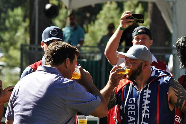 Fox New host Bret Baier chugs a beer in support of charity Thursday.