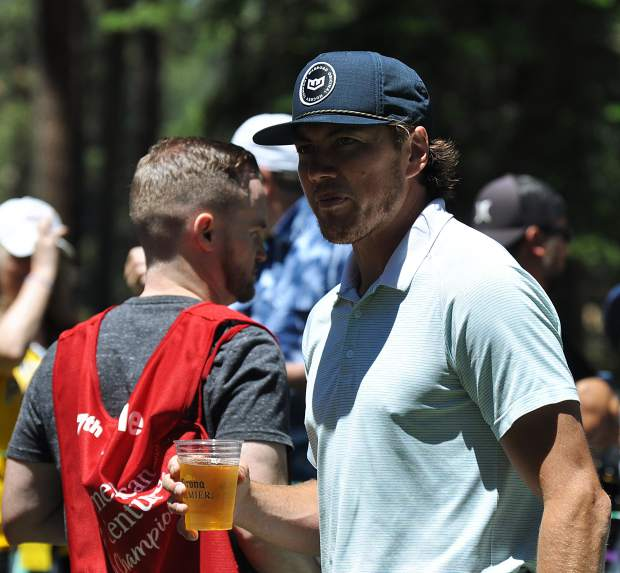 NHL player T.J. Oshie prepares to chug a beer for charity Thursday.