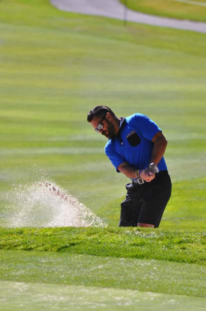 Los Angeles Rams free safety Eric Weddle hits a shot from the bunker Tuesday.