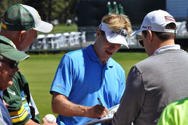 Actor Jack Wagner signs autographs Tuesday at the American Century Championship.