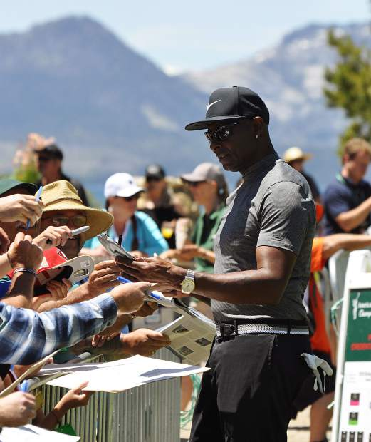 Hall of Fame wide receiver Jerry Rice signs autographs Tuesday at Edgewood Tahoe.