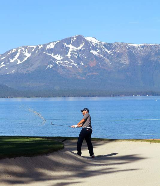 Retired Marine Jerry Woods hits out a bunker on the 17th hole Wednesday at Edgewood Tahoe.
