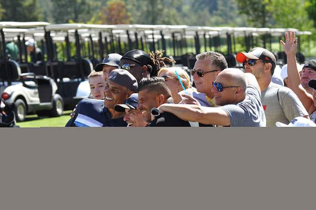 Former NFL player and coach Herm Edwards poses for a photo with a group of fans Wednesday.