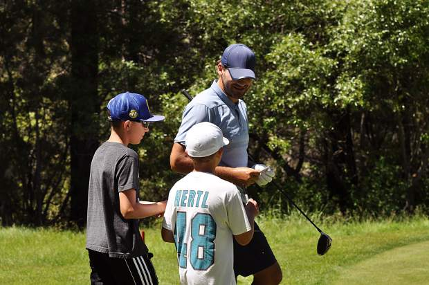 Young fans approach defending ACC champion Tony Romo for an autograph Wednesday.