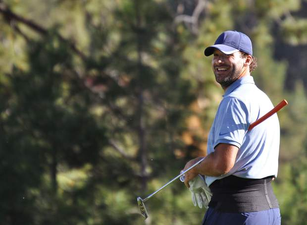 Defending ACC Champion Tony Romo flashes a smile Wednesday at Edgewood Tahoe.