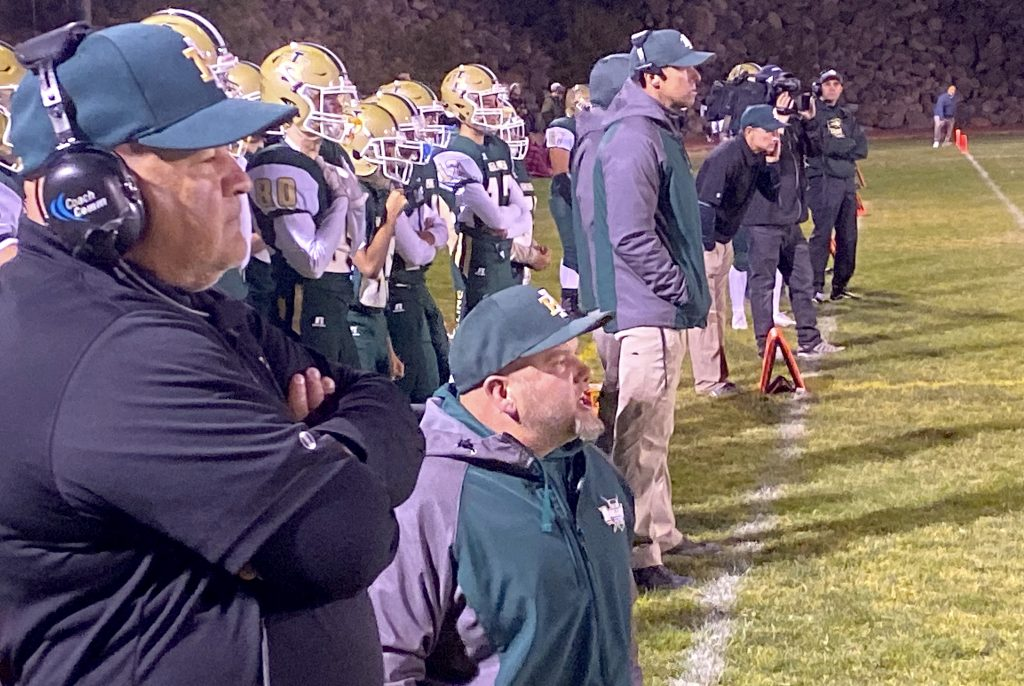 Incline's coaching staff watches the battle Friday night, Sept. 27, against Pershing County.