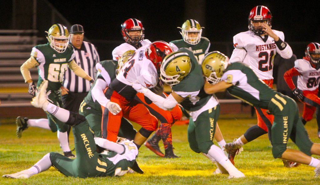 Incline's Jorge Cardiel (4) and Zach Fregoso (11) stop a Pershing County ball carrier.