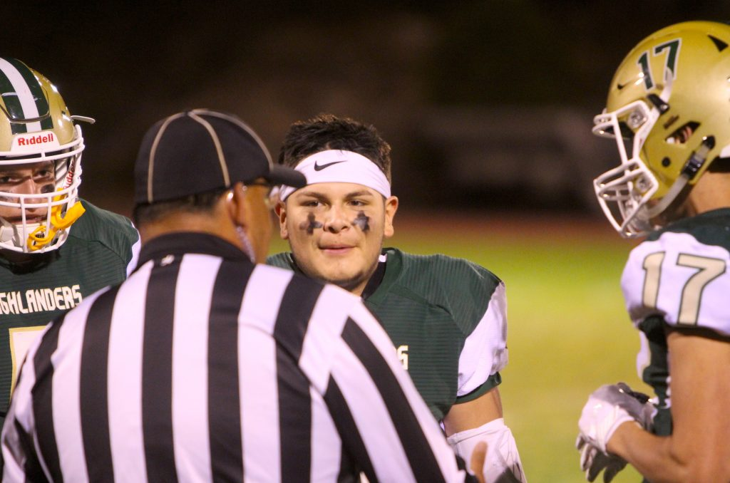 Incline's Brad Rye (left), Jorge Cardiel (center) and Dylan Cleary chat with an official Friday, Sept. 27, before the game.