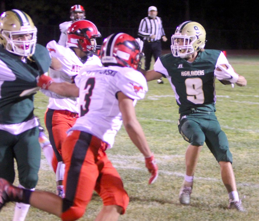 Incline's Jeremy Page looks for running room.