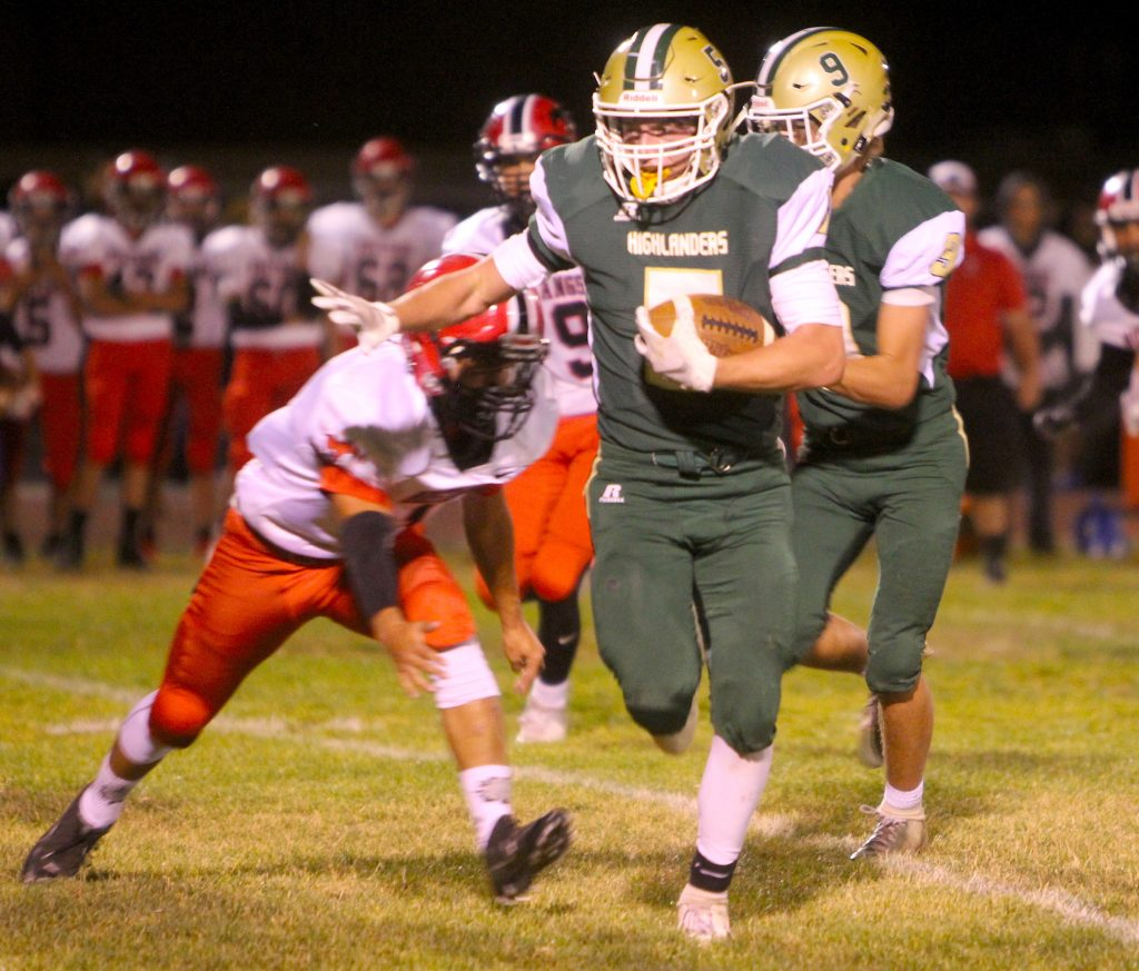 Incline's Brad Rye runs for a big chunk of yards Friday against Pershing County.