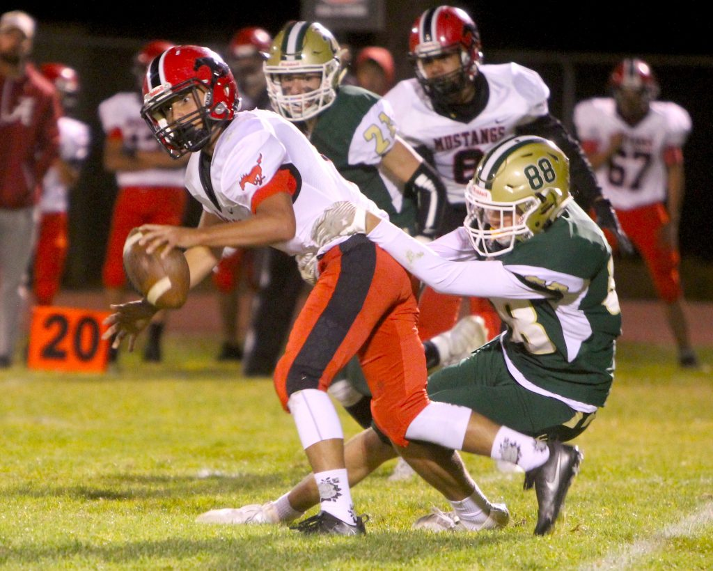 Incline's Brody Thralls (88) brings down a Pershing County quarterback Ricky Reitz Friday night, Sept. 27.