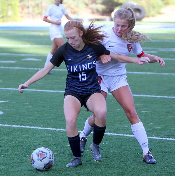 South Tahoe's Kelsey Hogan fights to keep possession.