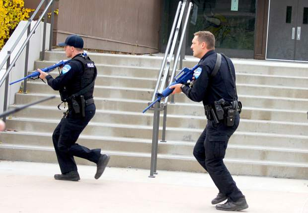 Police respond to shots fired during the active shooter drill.