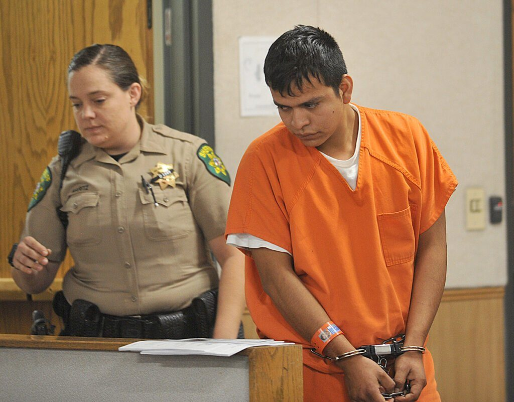 Ramiro Bravo Morales is led into court for an arraignment hearing Friday in the shooting death.