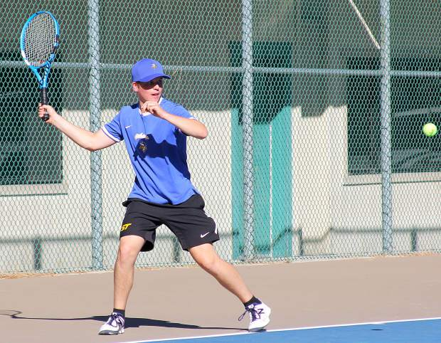 South Tahoe's No. 2 singles player Travis Lee prepares to lash a forehand.