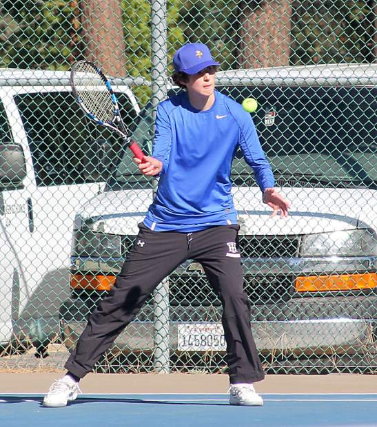 Quinn Proctor hits a volley during the No. 3 singles head-to-head match.