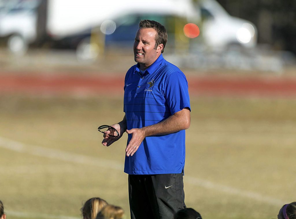 South Tahoe head coach Mark Salmon chats with his team Tuesday at Truckee.