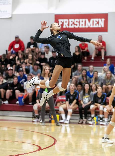 South Tahoe's Abrielle Bross leaps high for a kill attempt.