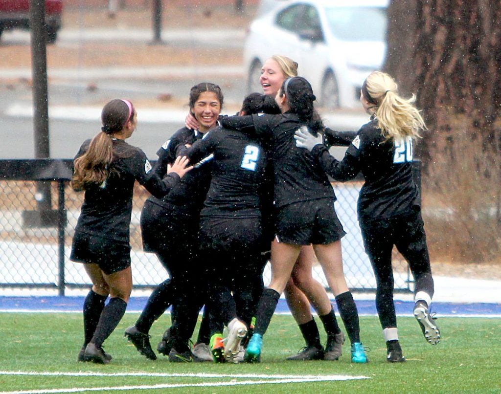 The Lady Coyotes celebrate a second half goal by Alexandra Trinidad.