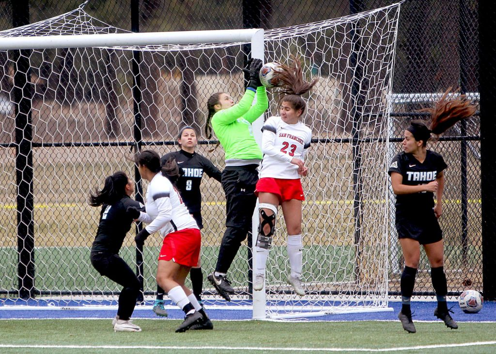 Coyotes keeper Madeline Smith makes a leaping save.