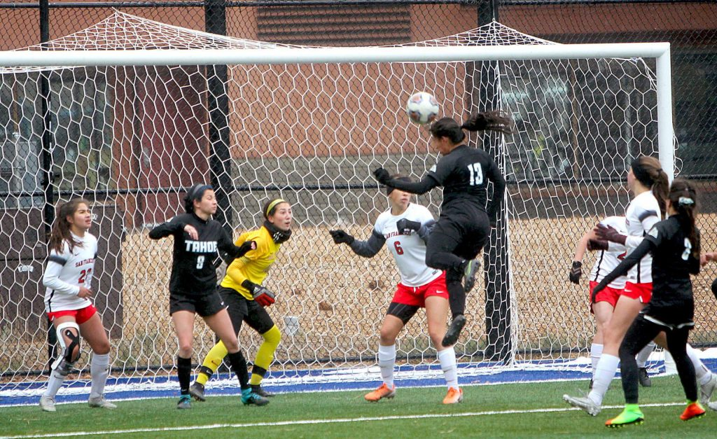 Angie Hurtado heads a shot off the crossbar.