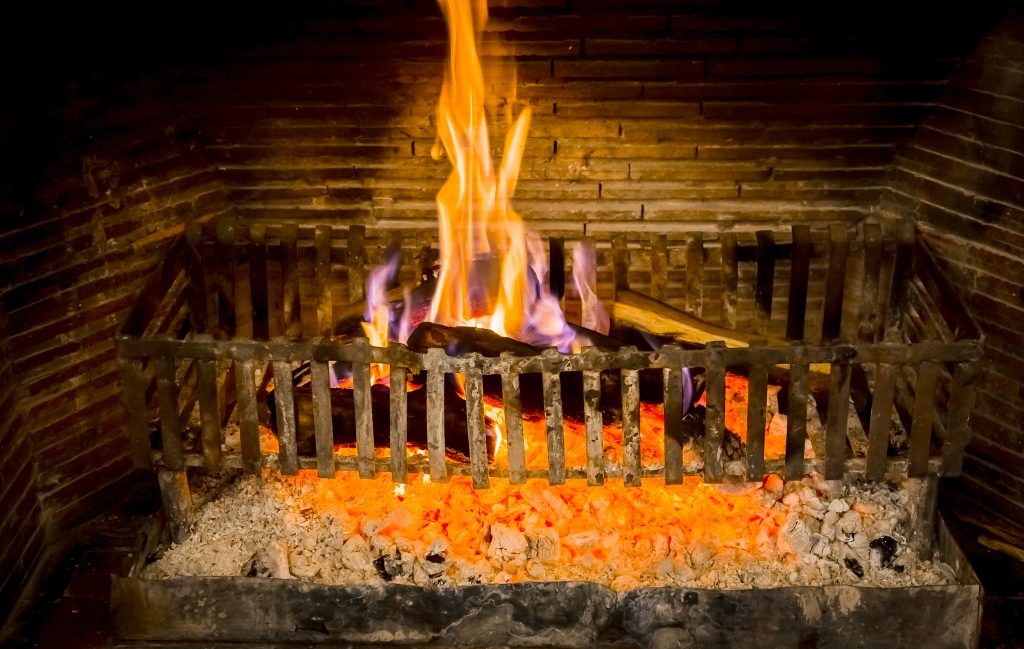 Burning logs in a fireplace can contribute to CO poisoning without proper ventilation.