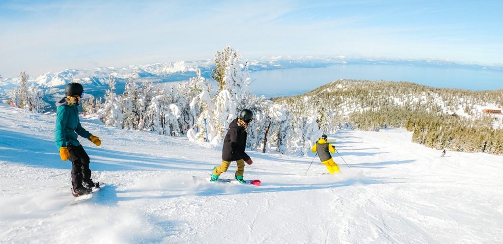 Skiers and snowboarders enjoy turns on the Tamarack trail.