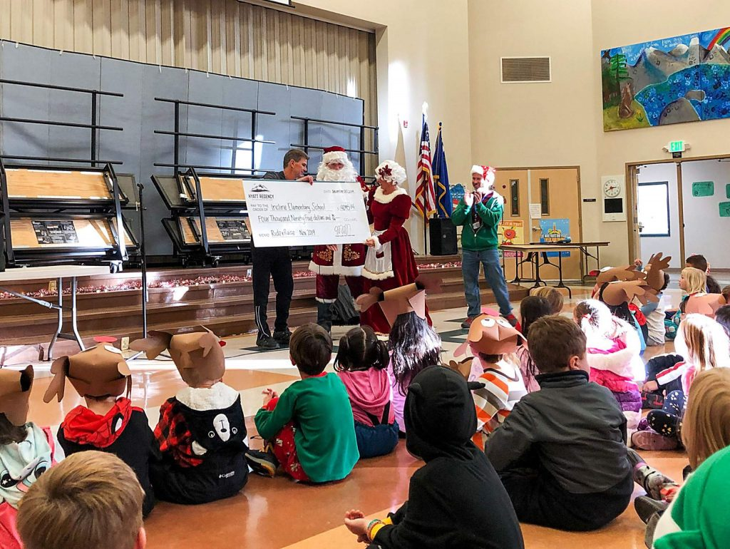 Santa and Mrs. Claus, and the team at Hyatt Regency Lake Tahoe Resort, Spa and Casino present a check for $4,095.14 to Incline Elementary School.