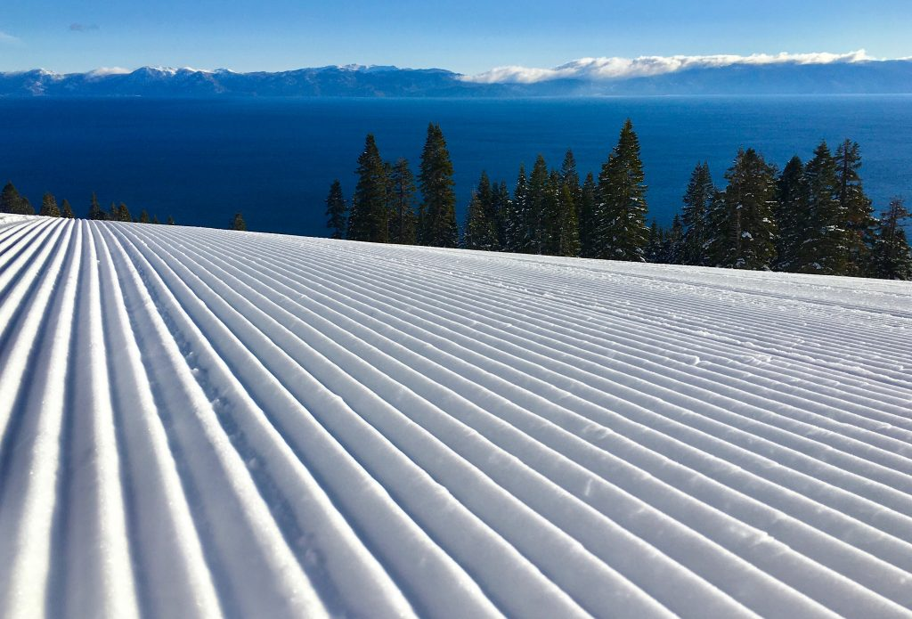A groomed trail with Lake Tahoe in the background Friday at Homewood Mountain Resort.