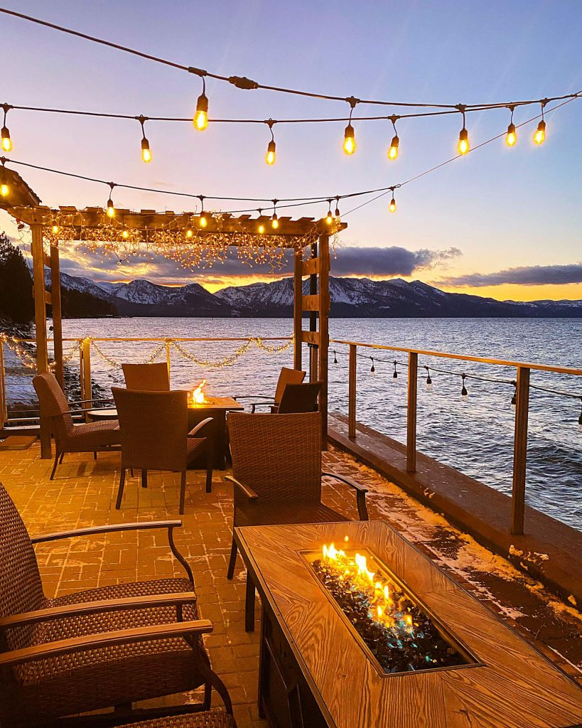 Idle Hour has firepits in their outside seating section with spectacular views of Lake Tahoe.