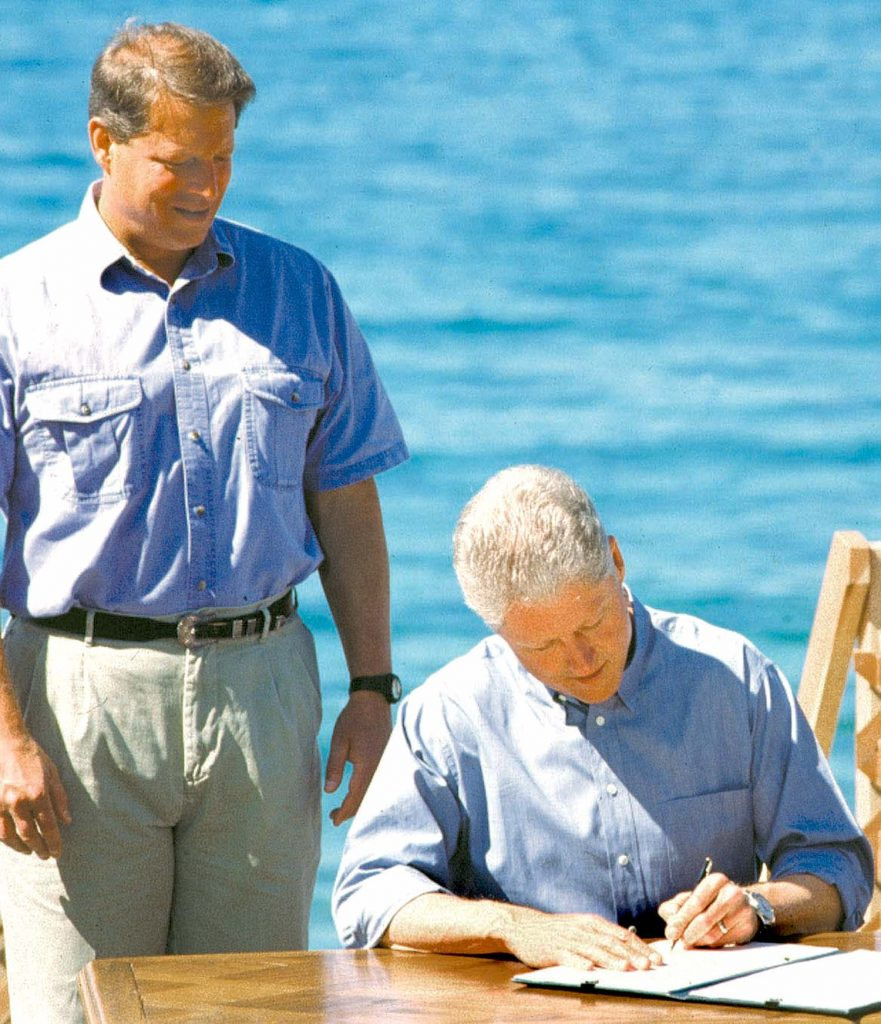 Vice President Al Gore, left, watches as President Bill Clinton signs the executive order earmarking $300 million for Lake Tahoe in 1997.