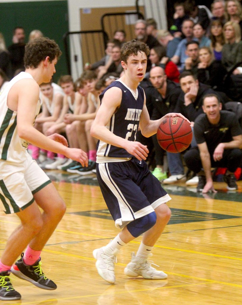 North Tahoe's Cameron McAndrews is guarded on the perimieter by Incline's Brody Thralls.