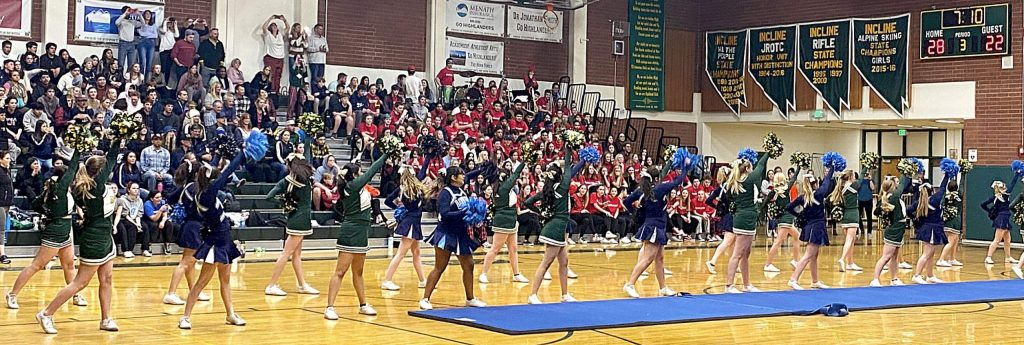 Incline and North Tahoe cheerleaders perform together Tuesday during halftime of the boys' game.