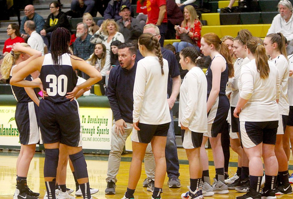 North Tahoe coach Jason Flesock talks with his team during a timeout.
