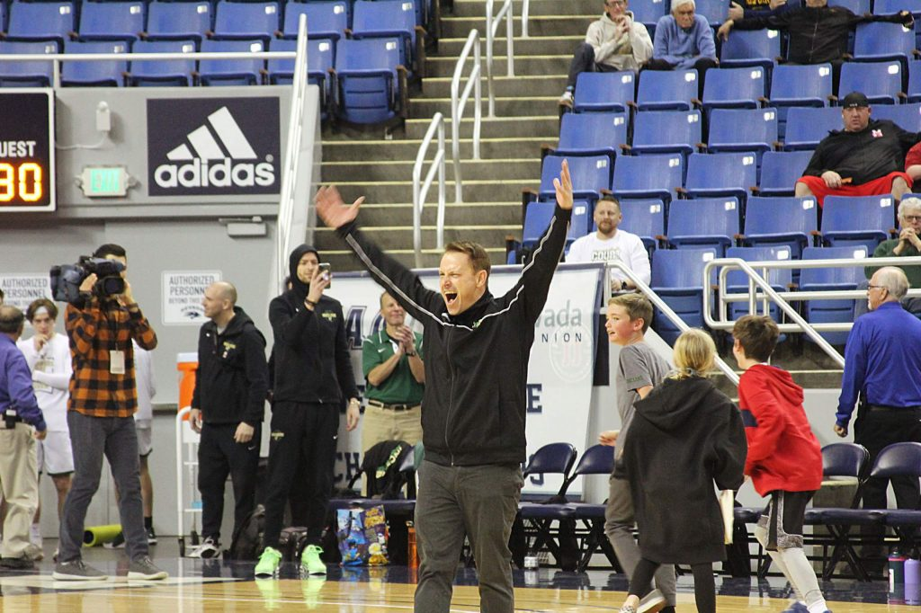 Incline head coach Indra Winquest celebrates a state championship.