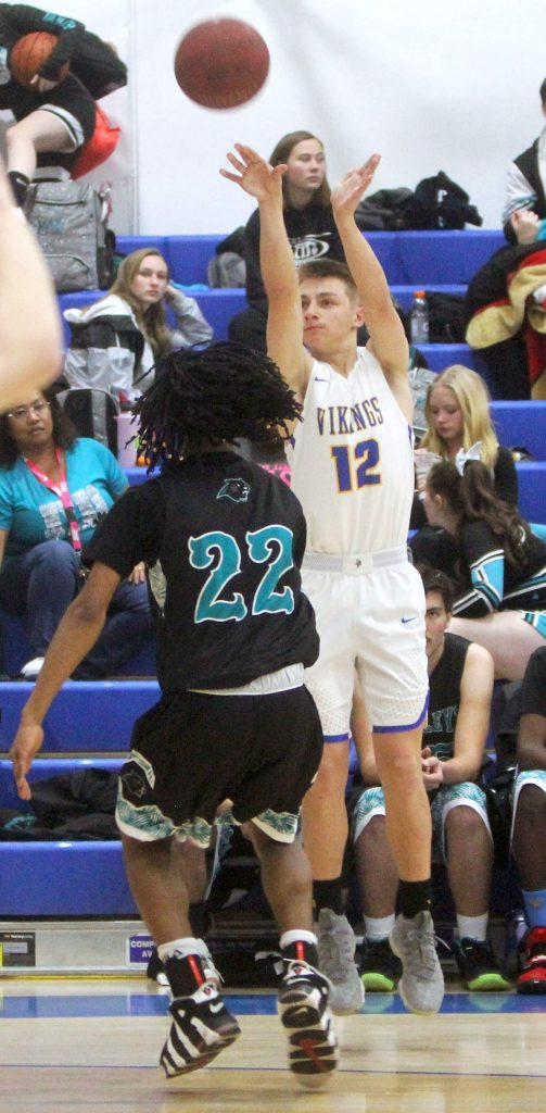 South Tahoe's Cameron Lehmann shoots a 3-pointer Tuesday night against North Valleys.