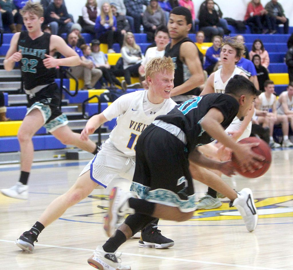 South Tahoe senior Logan Chapman takes pleasure in shutting down a North Valleys ball handler.